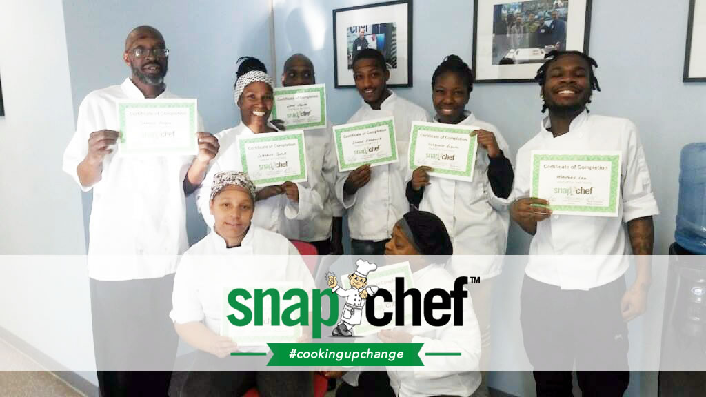 trainees holding their servsafe training certificates